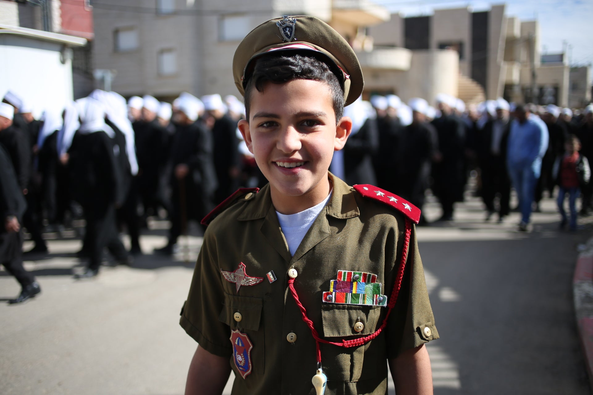 An Israeli Druze boy wears a military uniform at a protest in solidarity with Syrian Druze and in support of Bashar Assad, February 14, 2016.