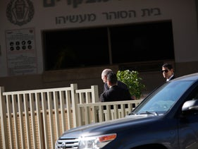 Former prime minister Ehud Olmert enters Ma'asiyahu Prison to begin serving a 19-month sentence, February 15, 2016.