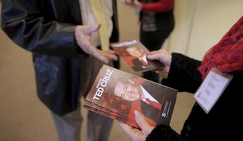 An usher at the Community Bible Church hands out programs featuring Republican presidential candidate Senator Ted Cruz, Beaufort, South Carolina, February 14, 2016.