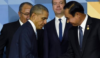 In this Nov. 19, 2015 file photo, President Barack Obama shakes hands with Thailand's Prime Minister Prayuth Chan-ocha in Manila, Philippines.