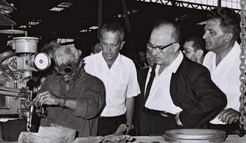 Prime Minister Levi Eshkol visiting a factory in 1965.