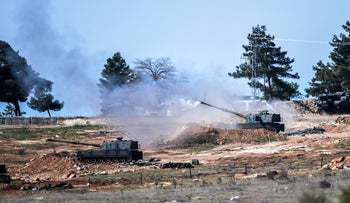 Turkish army tanks stationed near the town of Kilis fire towards the Syrian border, February 16, 2016.