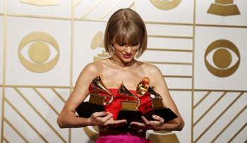 "Singer Taylor Swift poses backstage with her awards for Best Music Video for ""Bad Blood"", Album of the Year and Best Pop Vocal Album for ""1989"" during the 58th Grammy Awards in Los Angeles, February 15, 2016."