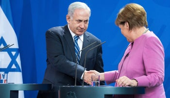 Angela Merkel shakes hands with Benjamin Netanyahu following their press conference during the German-Israeli government consultations in Berlin, February 16, 2016.