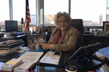 """Las Vegas Mayor Carolyn Goodman, showing a family photo in her office, says the """"Clinton names means a whole lot here,"""" Feb. 10, 2016."""