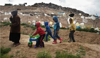 Bedouin children play in the Tarabin Asana village, some three kilometers from the Dudaim dump site, the biggest landfill in Israel, February 11, 2016.