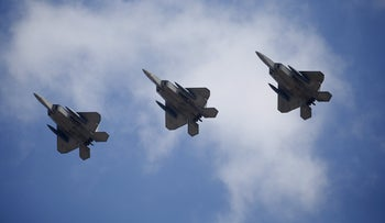 U.S. F-22 stealth fighter jets fly over Osan Air Base in Pyeongtaek, South Korea, February 17, 2016.