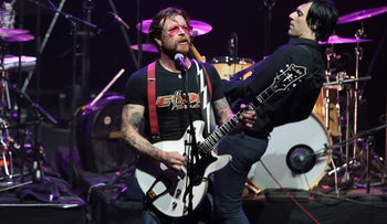 Jesse Hughes, center, at the Eagles of Death Metal concert in Paris on Tuesday night.
