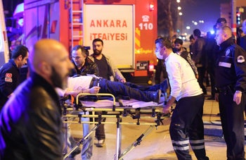 An injured person receives medical treatment by rescue workers following an explosion that targeted military vehicles in Ankara, Turkey, February 17, 2016.