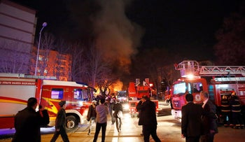 Smoke from a fire billows following an explosion as police and rescue services work on the area in Ankara, February 17, 2016.