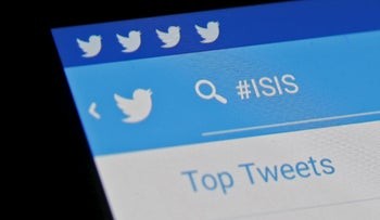 The Islamic State hashtag is seen typed into the Twitter application on a smartphone in this picture illustration taken in Zenica, Bosnia and Herzegovina, February 6, 2016.