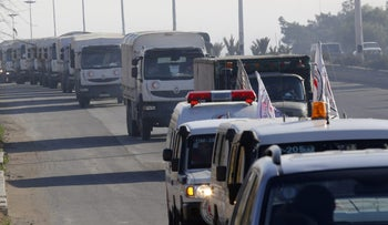 FILE PHOTO: A convoy of trucks loaded with humanitarian supplies heading to the besieged town of Madaya, January 2016.