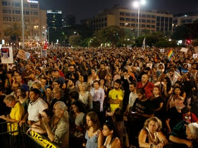 Thousands attend an anti-violence and incitement rally at Tel Aviv's Rabin Square, Sat. Aug. 1, 2015.