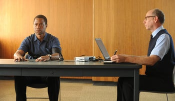In this image released by FX, Cuba Gooding Jr. portrays O.J. Simpson, left, in a scene from 'The People v. O.J. Simpson: American Crime Story,' a 10-part series debuting this month.