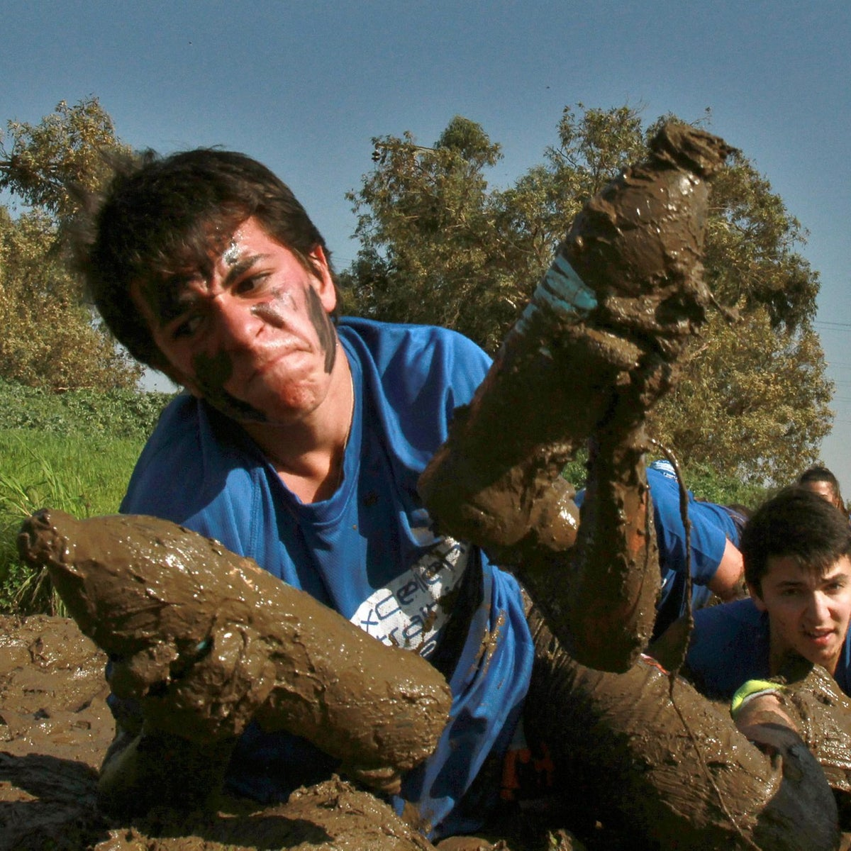 Israeli youths crawl in the mud as they take part in a training session for the Israeli Elite Army Units in the city of Herzliya, near Tel Aviv, on February 19, 2016.