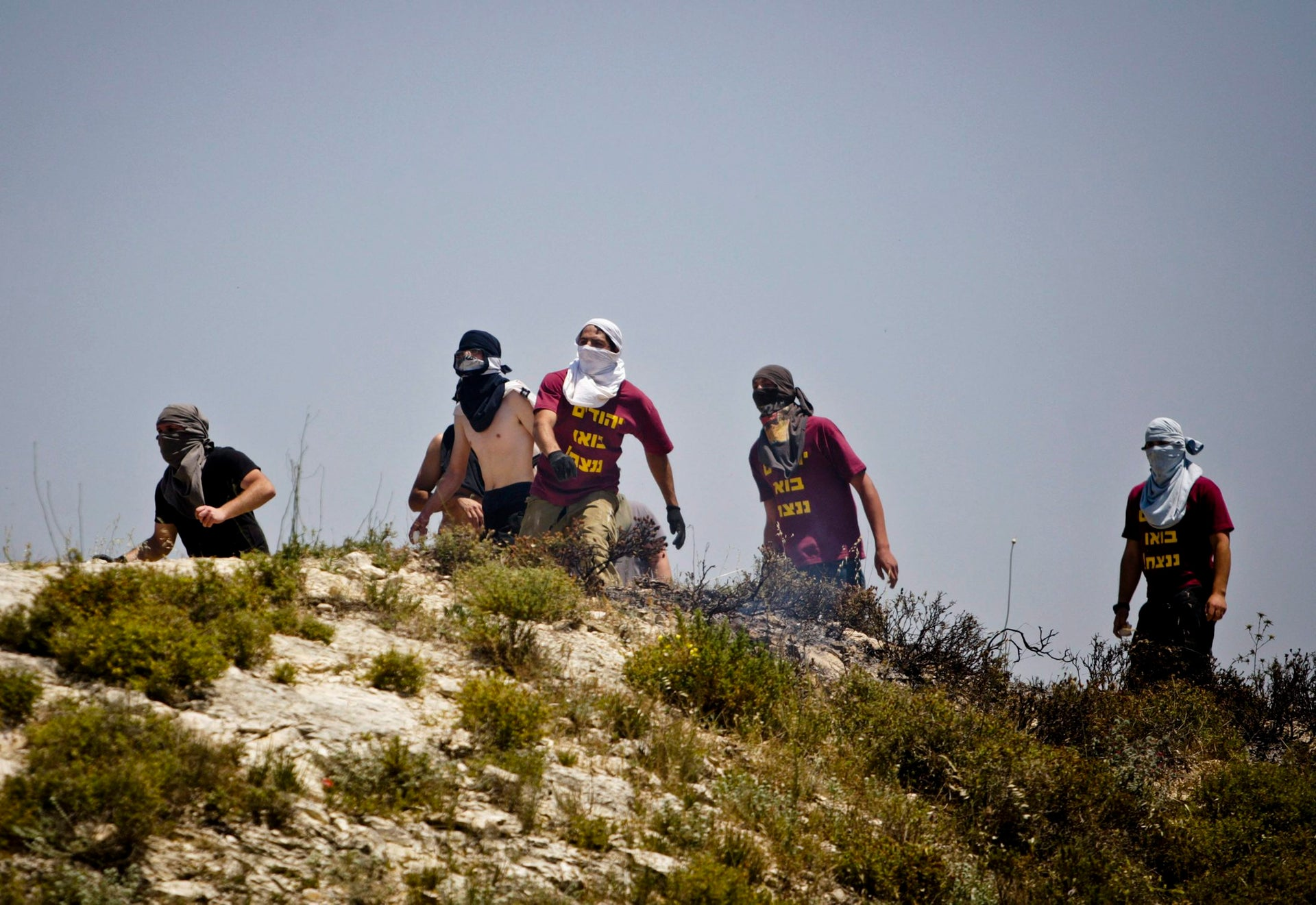 File photo of Jewish settlers throwing rocks towards Palestinians during clashes near the Jewish settlement of Yitzhar, near Nablus, April 30, 2013.