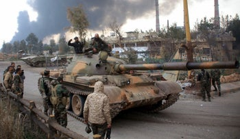 Syrian government forces patrol near Aleppo's thermal power plant after they took control of the area on the eastern outskirts of Syria's northern embattled city from ISIS fighters, February 21, 2016.