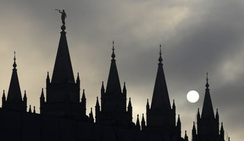 In this Feb. 6, 2013, file photo, the angel Moroni statue, silhouetted against a cloud-covered sky, sits atop the Salt Lake Temple, at Temple Square, in Salt Lake City.