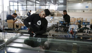Palestinian laborers work at Aluminum Construction, a factory located in the Industrial Park of the West Bank Jewish settlement of Maale Adumim, near Jerusalem, February 3, 2016.