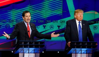 Presidential candidate Marco Rubio speaks as Donald Trump listens during a debate for the 2016 Republican U.S. presidential candidates in Houston, Texas, February 25, 2016.