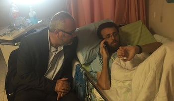Palestinian hunger striker al-Qiq with Joint Arab List MK Osama Saadi after deal to end his strike was announced. February 26, 2016.