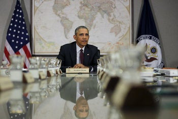 Obama attends a meeting at the National Security Council at the U.S. State Department, Washington February 25, 2016.
