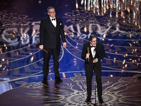 Screenwriter-director Adam McKay (L) and screenwriter Charles Randolph accept the Best Adapted Screenplay award for 'The Big Short' onstage during the 88th Annual Academy Awards at the Dolby Theatre on February 28, 2016 in Hollywood, California.