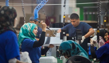 Employees working at the new SodaStream factory built deep in Israel's Negev Desert next to the city of Rahat, Israel, that will replace the West Bank facility when it shuts down in two weeks time, Sept. 2, 2015.