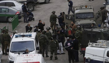 IDF forces at the scene of a shooting attributed to the brothers in January.