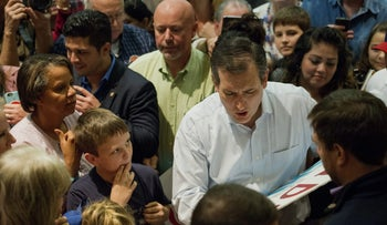 Senator Ted Cruz, a Republican from Texas and 2016 presidential candidate, signs an autograph for an attendee during a campaign event in San Antonio, Texas, U.S., on Monday February 29, 2016.