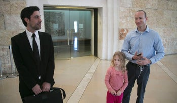 A petitioner seeking surrogacy rights, right, with his lawyer and daughter, Jerusalem, March 1, 2016.
