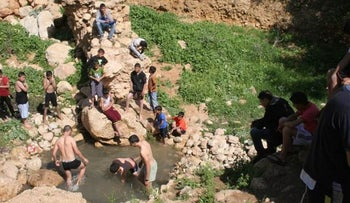 Settlers and Palestinians at the Ein Fasail pool don't speak to one another.