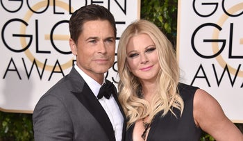 Rob Lowe, left, and Sheryl Berkoff arrive at the 73rd annual Golden Globe Awards on Sunday, Jan. 10, 2016, at the Beverly Hilton Hotel in Beverly Hills, Calif.