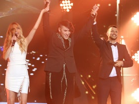 Hovi Star, flanked by 'Rising Star' hosts Rotem Sela and Assi Azar, is announced the winner of the show and Israel's delegate to the Eurovision Song Contest, March 3, 2016.