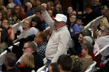 A Trump supporter cheers as U.S. Republican presidential candidate Donald Trump holds a rally with voters in Gaffney, South Carolina February 18, 2016.