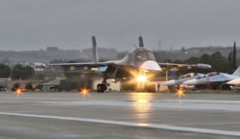 A Russian military jet takes off from the country's air base in Hmeymin, Syria to head back to Russia, part of a partial withdrawal ordered by President Vladimir Putin,on March 15, 2016.