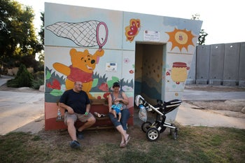 A bomb shelter adorned with a Winnie-the-Pooh illustration in Kibbutz Nahal Oz, near the Gaza border.