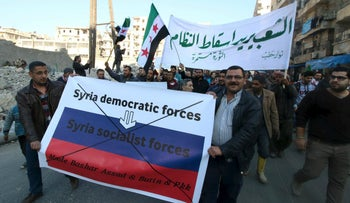 People attend a protest rally against forces loyal to Syrian President Bashar Assad and Russia, in the Tariq al-Bab neighbourhood of Aleppo, February 29, 2016.