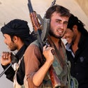 Free Syrian Army fighters hold their weapons in the suburb of Raqqa, eastern Syria September 13, 2013.
