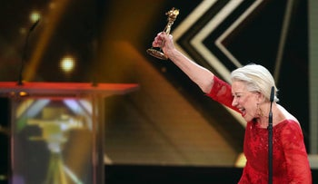 In this Feb. 6, 2016 picture British actress Helen Mirren reacts after receiving the Golden Camera media award as best actress International, in Hamburg, Germany.