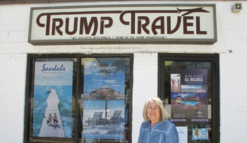 Claudia Rabin-Manning stands outside her Baldwin, N.Y. business, Trump Travel, April 6, 2016.