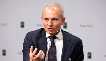 David Lidington, U.K. Europe Minister, gestures as he speaks at the European Banking Congress at the Alte Oper concert hall in Frankfurt, Germany, on Friday, Nov. 21, 2014.