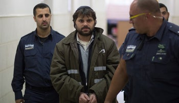 Yosef Chaim Ben-David, the primary suspect in the murder of Palestinian teen Mohammed Abu-Khdeir, is led into a Jerusalem court, Israel, December 21, 2015.