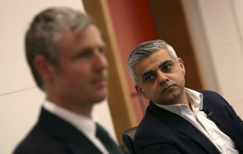 Sadiq Khan (right) with his mayoral challenger, Zac Goldsmith, at a hustings event in London, March 23, 2016.