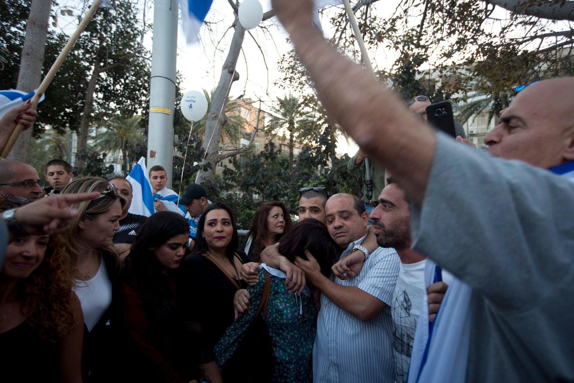 The family of an Israeli soldier accused of manslaughter at a rally for his release in Tel Aviv's Rabin Square.