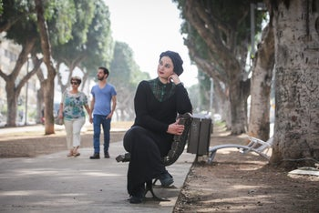 Ultra-Orthodox woman seen wearing traditional head-covering.