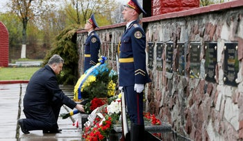 Ukrainian President Petro Poroshenko lays flowers during a commemoration ceremony for emergency workers who fought the blaze at the Chernobyl nuclear reactor, Ukraine, April 26, 2016.