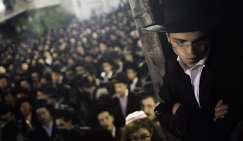 An Ultra Orthodox Jew looks on at a protest in front of the main army recruitment office in Jerusalem. May 2013.