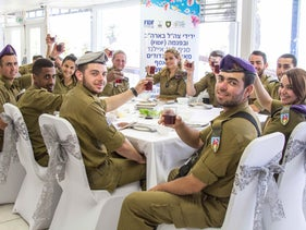 Soldiers from the Givati Brigade and Combat Engineering Corps celebrate Passover at a seder in Ashkelon, April 22, 2016.