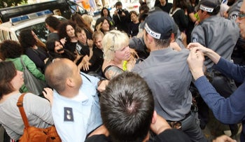 Demonstrators protesting the arrests at the draft evasion march, outside the Dizengoff Street police station in Tel Aviv, 2009.